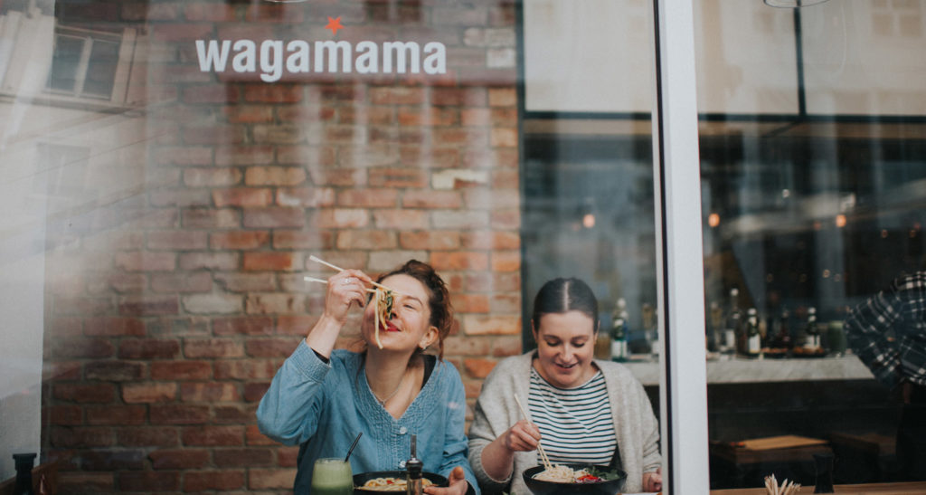 Guests enjoying food from Wagamama